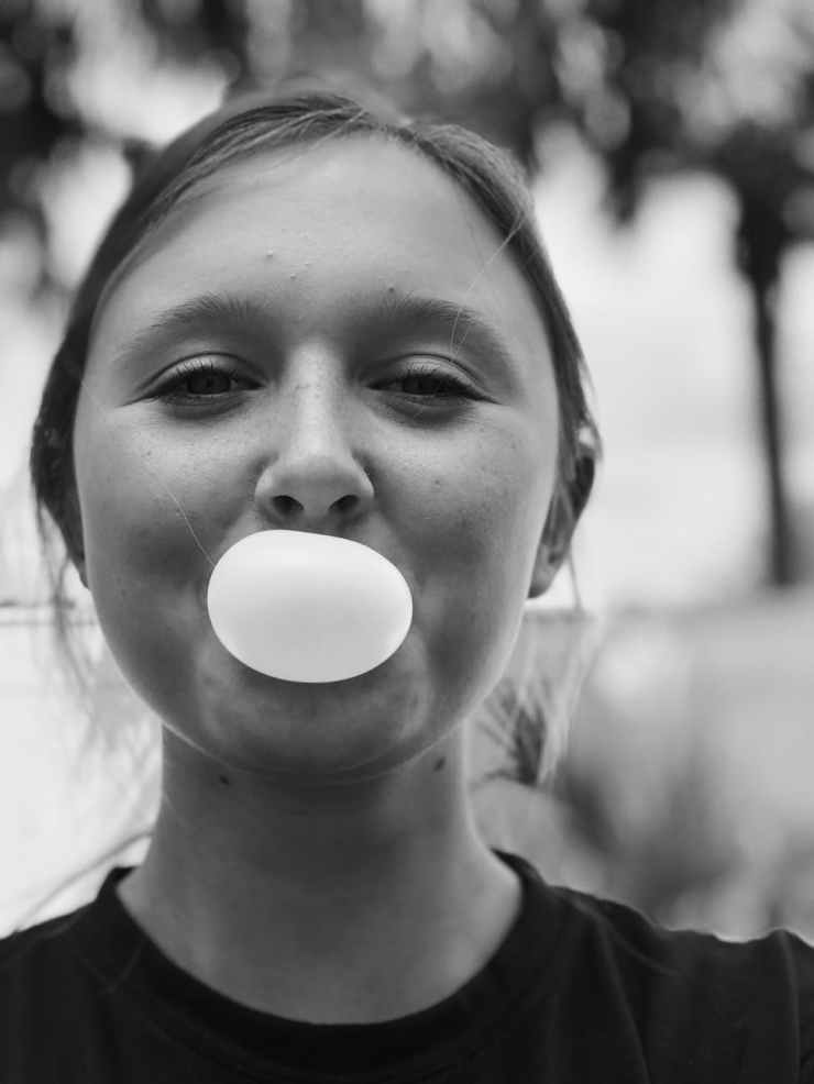 woman blowing bubblegum